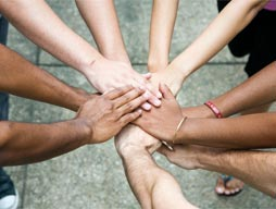 Hands coming together from many different ethnicities or skin colours